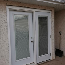 All Weather windows and garden door installed with clipstone accent